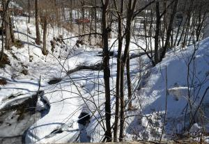 Frozen stream beside the West Minot Sugar House.